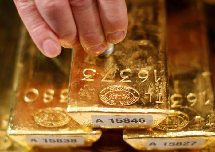 Gold hits near six-week low on firmer dollar, higher Treasury yields